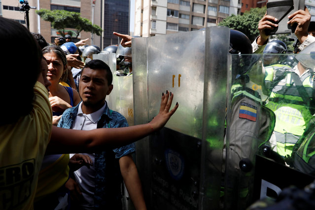 Security forces block demonstrators using riot shields during an opposition rally in Caracas, Venezuela on April 4, 2017. (Photo by Carlos Garcia Rawlins/Reuters)