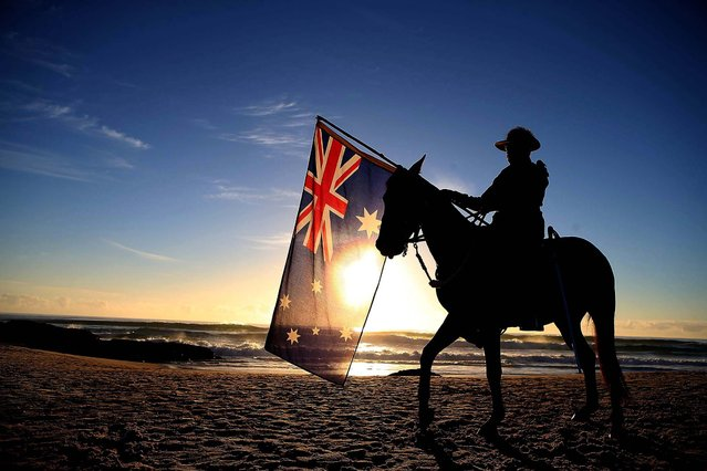 A member of the Mudgeeraba light horse troop takes part in the ANZAC dawn service at Currumbin Surf Life Saving Club in Gold Coast, Australia, on April 25, 2014. Veterans, dignitaries and members of the public marked the 99th anniversary of ANZAC (Australia New Zealand Army Corps) Day, when allied First World War forces landed on the Gallipoli Peninsula. (Photo by Chris Hyde/Getty Images)