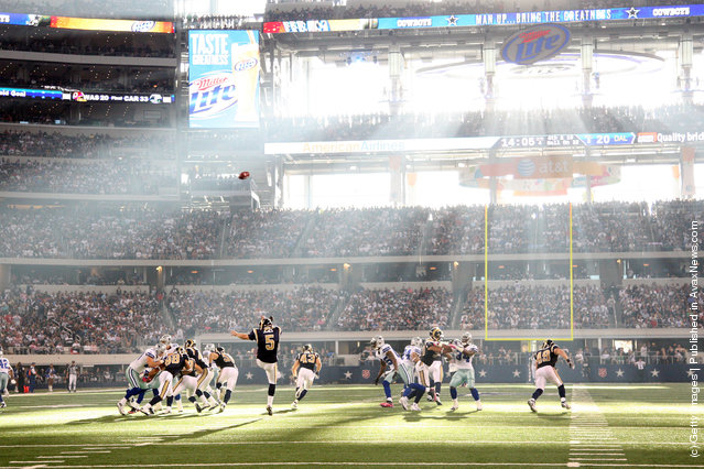 Donnie Jones #5 of the St. Louis Rams punts into the sun against the Dallas Cowboys at Cowboys Stadium