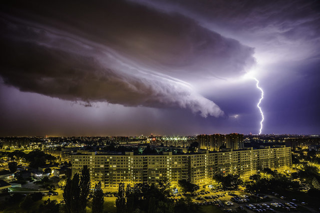 A picture made available on 08 July 2015 showsa  lightning strikes during a heavy storm over Poznan in the night of 07 July 2015. Severe storms passed last night over Poland causing lots of damages to buildings, trees, electricity and railway tractions. (Photo by Lukasz Ogrodowczyk/EPA)