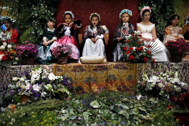 """""""Maya"""" girls sit at an altar during """"Las Mayas"""" festivity in Madrid, Spain, May 8, 2016. (Photo by Susana Vera/Reuters)"""