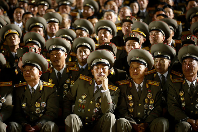 Military officers follow a mass dance event marking the 105th birth anniversary of the country's founding father, Kim Il Sung, in Pyongyang, North Korea April 15, 2017. (Photo by Damir Sagolj/Reuters)