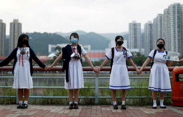 Anti-government protesters hold hands to prepare a human chain in Sha Tin at the banks of the Shing Mun River in Hong Kong, China on September 19, 2019. China's foreign ministry on Thursday accused U.S. congressional leader Nancy Pelosi of making irresponsible remarks about pro-democracy protests in Hong Kong, one day after she welcomed activists from the city to the U.S. Capitol. (Photo by Jorge Silva/Reuters)
