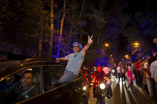 Iranians celebrate in the streets following a nuclear deal with six major world powers in Tehran July 14, 2015. (Photo by Reuters/TIMA)