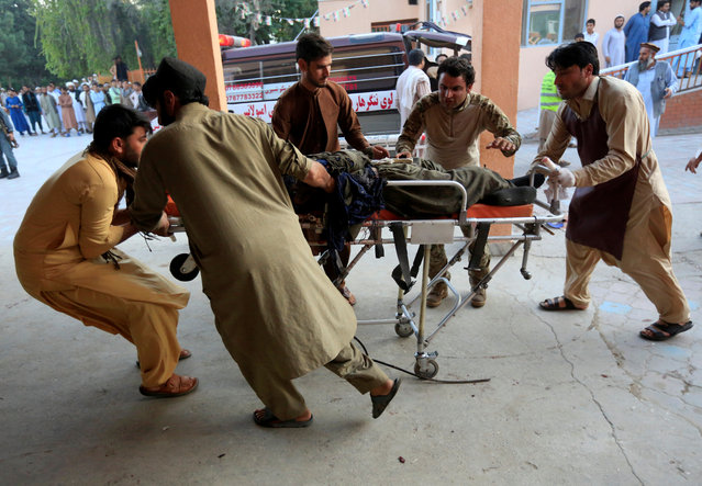 Men carry an injured person to a hospital after a blast in Jalalabad, Afghanistan on October 7, 2019. (Photo by Reuters/Parwiz)