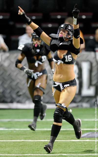 Natalie Jahnke #16 of the Los Angeles Temptation celebrates after the team scored a touchdown against the Philadelphia Passion during the Lingerie Football League's Lingerie Bowl IX