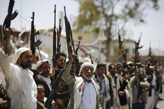 Shiite Houthi tribesmen hold their weapons as they chant slogans during a tribal gathering showing support for the Houthi movement, in Sanaa, Yemen, Thursday, May 19, 2016. On Tuesday the Yemeni Foreign Minister Abdul-Malik al-Mekhlafi announced the suspension of peace talks held in Kuwait with Shiite rebels after weeks of no progress, saying the rebels refuse to accept the legitimacy of the country's internationally-recognized president. (Photo by Hani Mohammed/AP Photo)