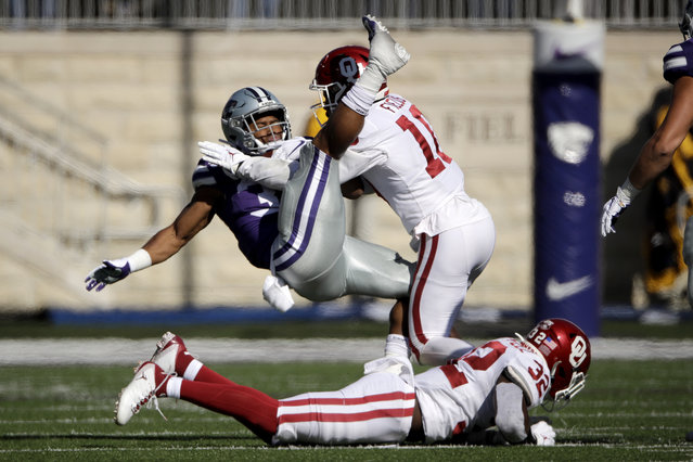 Kansas State running back James Gilbert is tackled by Oklahoma safety Pat Fields (10) during the first half of an NCAA college football game Saturday, October 26, 2019, in Manhattan, Kan. (Photo by Charlie Riedel/AP Photo)