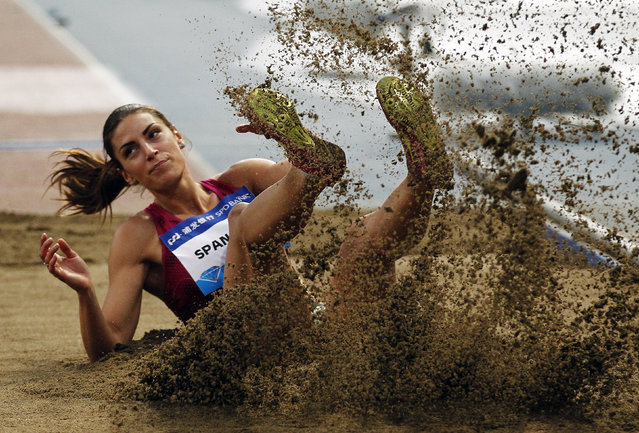Ivana Spanovic of Serbia competes at the women's long jump at the IAAF Diamond League athletics meet in Shanghai May 18, 2014. (Photo by Carlos Barria/Reuters)