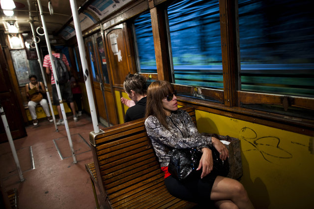 Passengers travel in a wooden carriage car on the historic subway system, Line A, in Buenos Aires, Argentina, Wednesday, January 2, 2013. (Photo by Natacha Pisarenko/AP Photo)