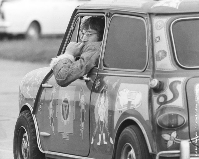 Singer and songwriter John Lennon (1940 - 1980) of the Beatles, in a psychedelic Radford Mini de Ville owned by George Harrison at West Malling Airfield, Kent, 7th November 1967. The Beatles are at the Aerodrome for work on their TV film 'Magical Mystery Tour'