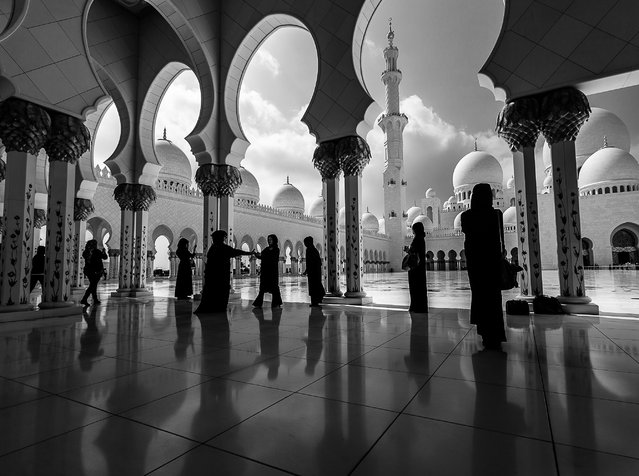 """""""Women in Black"""". Taken at the iconic Grand Mosque or Sheikh Zayed Mosque of Abu Dhabi. The mosque is open to all nationalities and religion. ladies entering the mosque should wear the black Abaya(Arabic dress) to enter the mosque. Photo location: Abu Dhabi, UAE. (Photo and caption by Sreeranj Sreedhar/National Geographic Photo Contest)"""
