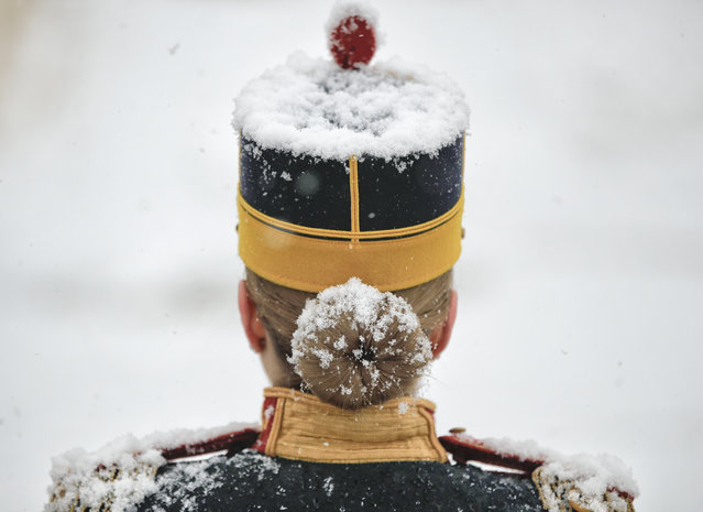 Snow falls on a honor guard soldier before the welcoming ceremony for Slovenia's President Borut Pahor at the Cotroceni presidential palace in Bucharest, Romania, Tuesday, January 15, 2019. (Photo by Vadim Ghirda/AP Photo)
