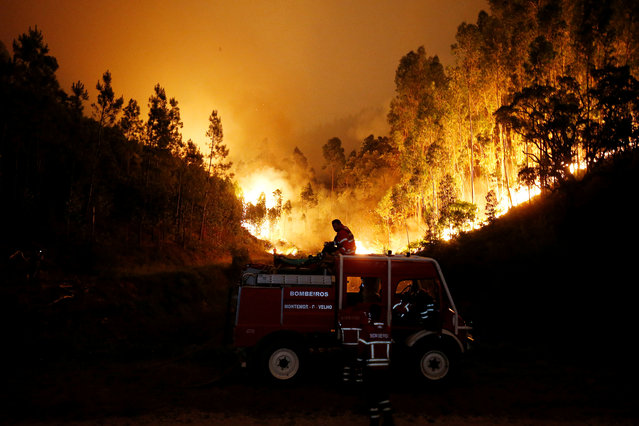 Firefighters work to put out a forest fire near Bouca, in central Portugal, June 18, 2017. (Photo by Rafael Marchante/Reuters)