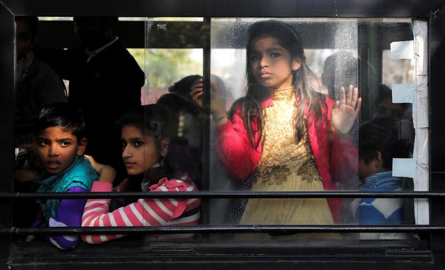 People observe a protest against a new citizenship law from a bus, in New Delhi, India, January 3, 2020. (Photo by Anushree Fadnavis/Reuters)
