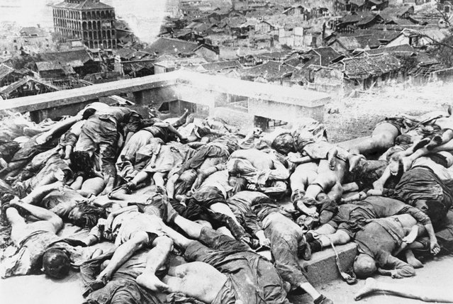Bodies of dead Chongqing citizens lie in piles after some 700 people were reportedly killed by a Japanese bombing raid on China in July of 1941. Between 1939 and 1942, more than three thousand tons of bombs were dropped by Japanese aircraft over Chongqing, resulting in well over 10,000 civilian casualties