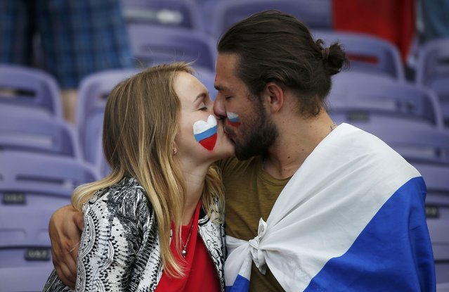 Football Soccer, Russia vs Wales, EURO 2016, Group B, Stadium de Toulouse, Toulouse, France on June 20, 2016. A Russian couple kiss before the match. (Photo by Sergio Perez/Reuters)