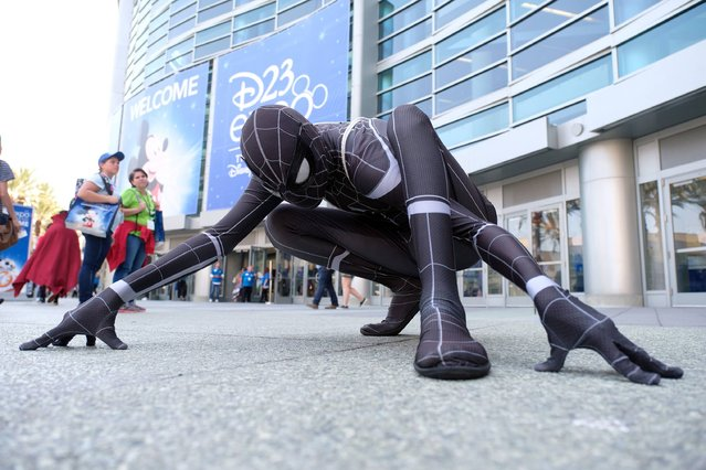 Fans and cosplayers attend the D23 expo fan convention at the convention center in Anaheim, California on July 14, 2017. (Photo by Chris Delmas/AFP Photo)