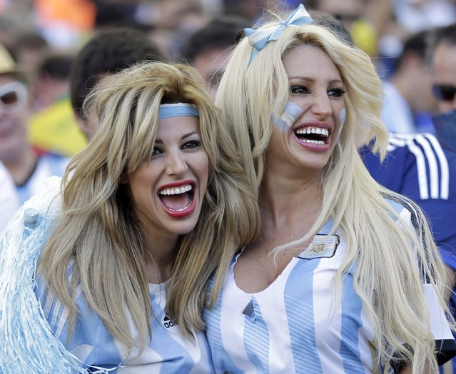 Argentine supporters pose before the World Cup final soccer match between Germany and Argentina at the Maracana Stadium in Rio de Janeiro, Brazil, Sunday, July 13, 2014. (Photo by Natacha Pisarenko/AP Photo)