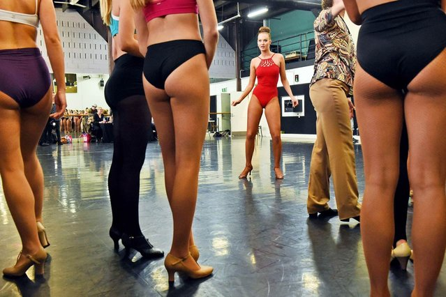 Dancers audition for the famous Moulin Rouge in Paris which celebrates its 125th birthday this year, in Sydney on July 15, 2014. The dancers are auditioning for a place in the show which consists of a troupe of 60 artists who perform twice on stage every evening, 365 days a year, with 1000 made to measure costumes, a giant aquarium, five pythons and six miniature horses. (Photo by William West/AFP Photo)