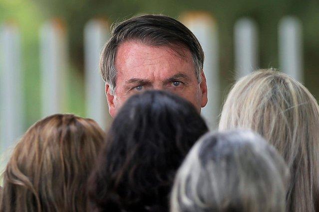 Brazil's President Jair Bolsonaro looks on as he leaves the Alvorada Palace in Brasilia, Brazil on February 4, 2020. (Photo by Adriano Machado/Reuters)