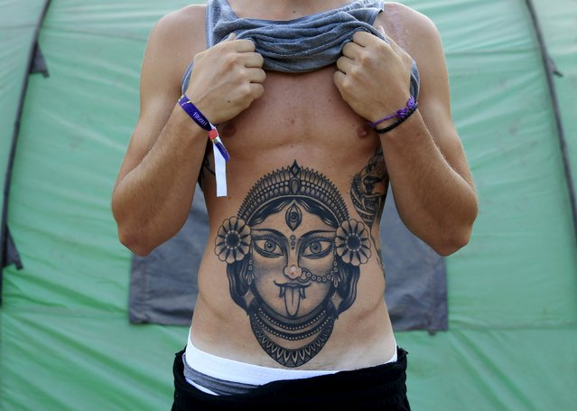 Sebastiano Benedetti, 23, from Italy shows his tattoo during the Sziget music festival on an island in the Danube River in Budapest, Hungary, August 14, 2015. (Photo by Bernadett Szabo/Reuters)