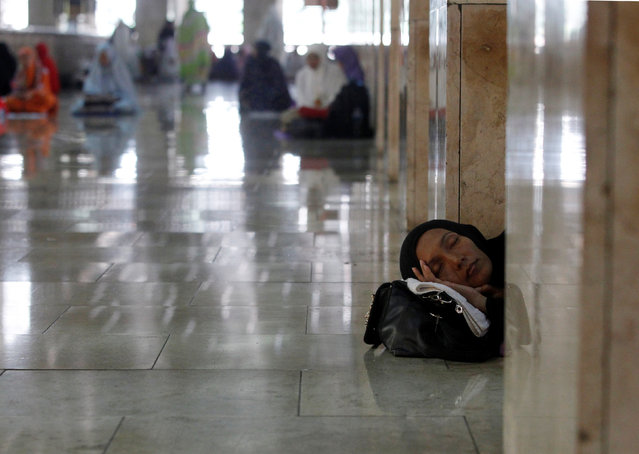 A Muslim woman sleeps inside Istiqlal mosque during the holy fasting month of Ramadan in Jakarta, Indonesia  July 1, 2016. (Photo by Iqro Rinaldi/Reuters)
