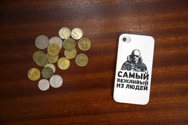 """A mobile phone cover depicting Russian President Vladimir Putin and which reads """"The most polite person"""" is seen in this photo illustration taken in a hotel room in Kazan, Russia, August 5, 2015. (Photo by Stefan Wermuth/Reuters)"""