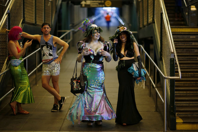Participants of the Mermaid Parade arrive in a subway station in Brooklyn, New York June 18, 2016. The annual parade, founded in 1983, seeks to bring mythology to life for residents, create confidence in the district and to allow artistic self-expression in public, according to the parade's website. (Photo by Eduardo Munoz/Reuters)