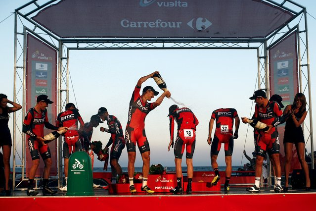 BMC Racing Team riders spray champagne after winning the 7.4 km (4.6 miles) team time trial in the first stage of the Vuelta Tour of Spain cycling race from Puerto Banus to Marbella, in Marbella, southern Spain, August 22, 2015. (Photo by Jon Nazca/Reuters)