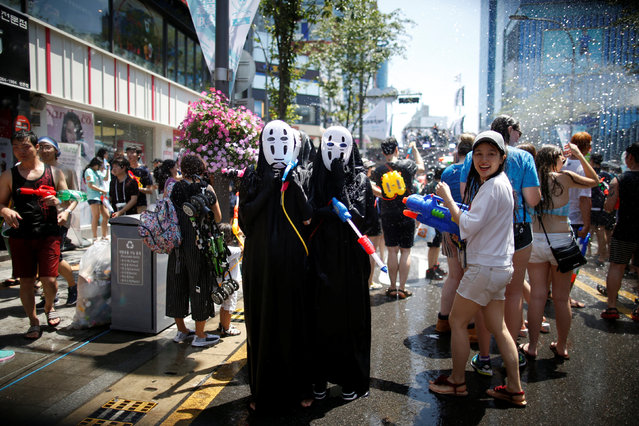 Participants play with water guns during the Sinchon Water Gun Festival in Seoul, South Korea, July 9, 2016. (Photo by Kim Hong-Ji/Reuters)