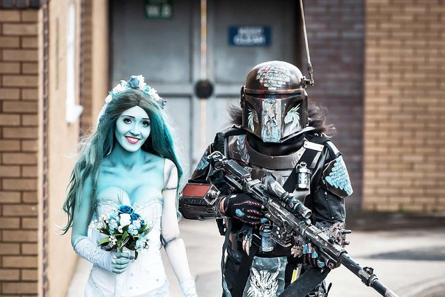 Natalia Williams dressed as Corpse Bride Emily and Tony Knight as a Mandalorian, arrive at the Bradford Unleashed Comic-Con, an entertainment and comic book convention in England on March 8, 2020. (Photo by Danny Lawson/PA Images via Getty Images)