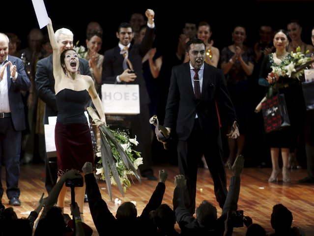 Jonathan Saavedra (R) and Clarisa Aragon from Argentina, who are representing the Argentine city of Cordoba, react after winning the Tango World Championship in Salon style, in Buenos Aires August 26, 2015. (Photo by Marcos Brindicci/Reuters)