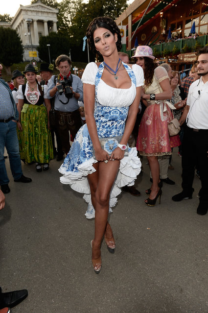 "Micaela Schaefer attends the ""Almauftrieb"" as part of the Oktoberfest beer festival at Kaefer tent at Theresienwiese on September 22, 2013 in Munich, Germany. (Photo by Luca Teuchmann/Getty Images)"