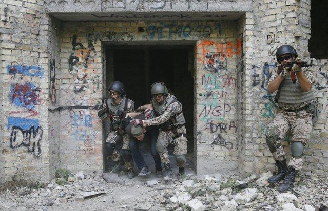 A mock terrorist is detained by members of the Ukrainian Interior Ministry's special battalion Kiev-1 during an anti-terror drill in Kiev, Ukraine, August 28, 2015. (Photo by Valentyn Ogirenko/Reuters)