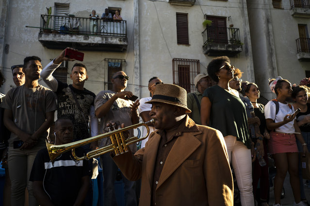 A Cuban trumpeter plays during the music conga through the streets of Old Havana within the activities of the 35th Havana Jazz Plaza festival in Havana, Cuba, Wednesday, January 15, 2020. (Photo by Ramon Espinosa/AP Photo)
