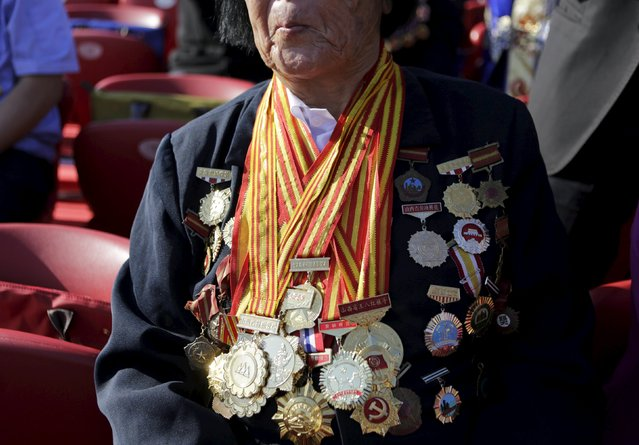 Shen Jilan wearing insignias and medals sits, ahead of the military parade to mark the 70th anniversary of the end of World War Two, in Beijing, China, September 3, 2015. (Photo by Jason Lee/Reuters)