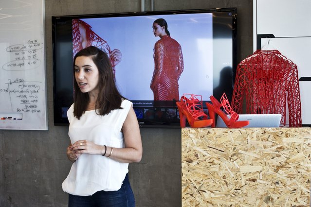 Israeli fashion design student from the Shenkar College of Engineering and Design Danit Peleg speaks to fashion bloggers about her 3-D printed graduate collection during a conference in Tel Aviv, Israel September 3, 2015. (Photo by Nir Elias/Reuters)