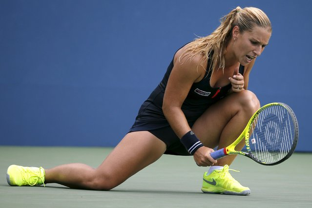 Dominika Cibulkova of Slovakia hits the court with her racket after losing a point to Eugenie Bouchard of Canada during their women's singles third round match at the U.S. Open Championships tennis tournament in New York, September 4, 2015. (Photo by Mike Segar/Reuters)