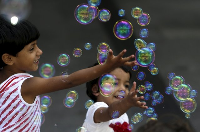 Migrant children play with bubbles at Keleti railway station in Budapest, Hungary, September 6, 2015. (Photo by David W. Cerny/Reuters)