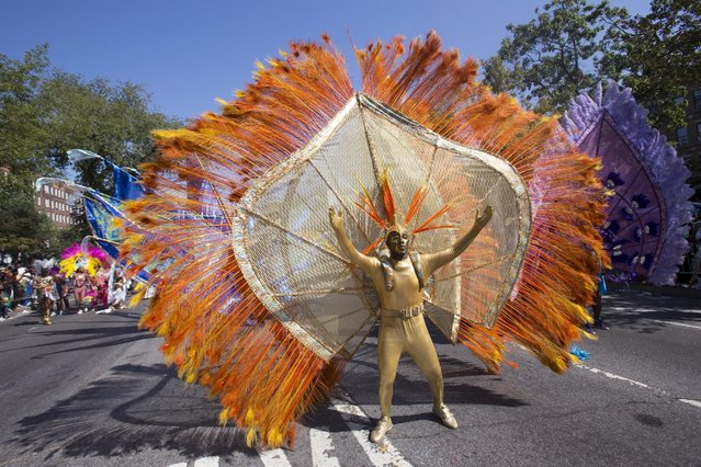 A participant dances during the West Indian Day Parade in Brooklyn, New York September 7, 2015. (Photo by Andrew Kelly/Reuters)