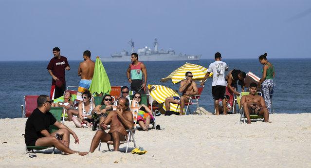 Navy vessels patrol the coast off of the famed Copacabana  beach on August 2, 2016 in Rio De Janeiro, Brazil. (Photo by Jonathan Newton/The Washington Post)