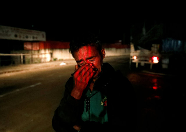 A stranded man cries as he looks for a shelter to spend the night in during the twenty-sixth day of the lockdown imposed by the government amid concerns about the spread of the coronavirus disease (COVID-19), in Kathmandu, Nepal on April 18, 2020. (Photo by Navesh Chitrakar/Reuters)