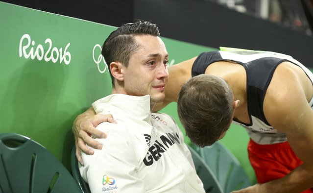 2016 Rio Olympics, Artistic Gymnastics, Preliminary, Men's Qualification, Subdivisions, Rio Olympic Arena, Rio de Janeiro, Brazil on August 6, 2016. Andreas Toba (GER) of Germany is consoled by teammate Lukas Dauser (GER) during the men's qualifications. (Photo by Mike Blake/Reuters)