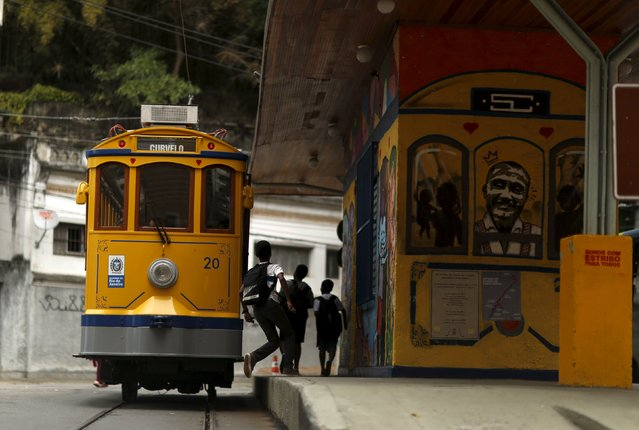 Children run to board the bonde, the typical tram line in Santa Teresa neighborhood in Rio de Janeiro, Brazil, September 9, 2015. (Photo by Pilar Olivares/Reuters)