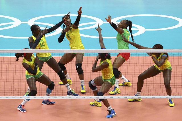 2016 Rio Olympics, Women's Preliminary, Pool A Argentina vs Cameroon on August 12, 2016. Laeticia Moma (CMR) of Cameroon (C) celebrates a point with team mates. (Photo by Yves Herman/Reuters)