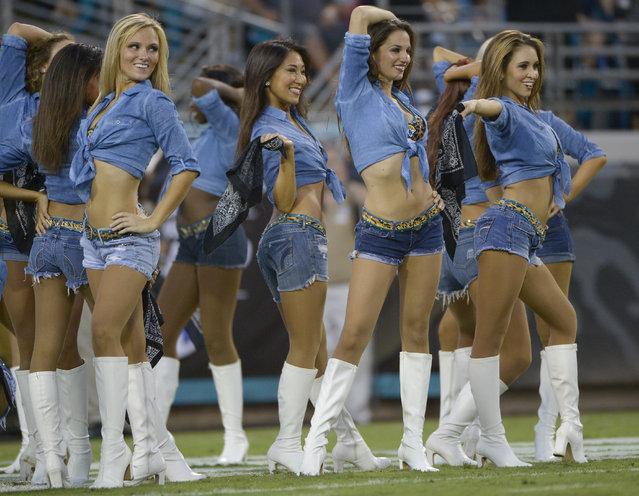 Jacksonville Jaguars cheerleaders perform during the first half of an NFL preseason football game against the Tampa Bay Buccaneers in Jacksonville, Fla., Friday, August 8, 2014. (Photo by Phelan M. Ebenhack/AP Photo)