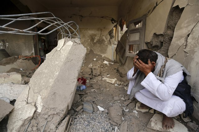 A man who lost his relatives in a Saudi-led air strike cries at the site of the air strike in Yemen's capital Sanaa September 21, 2015. (Photo by Khaled Abdullah/Reuters)