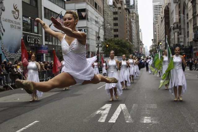 Revellers take part in the the 70th Annual Columbus Day Parade in New York, October 13, 2014. (Photo by Eduardo Munoz/Reuters)
