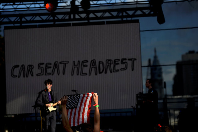 A fan holds an American flag as Car Seat Headrest plays during the fifth annual Made in America Music Festival in Philadelphia, Pennsylvania September 3, 2016. (Photo by Mark Makela/Reuters)